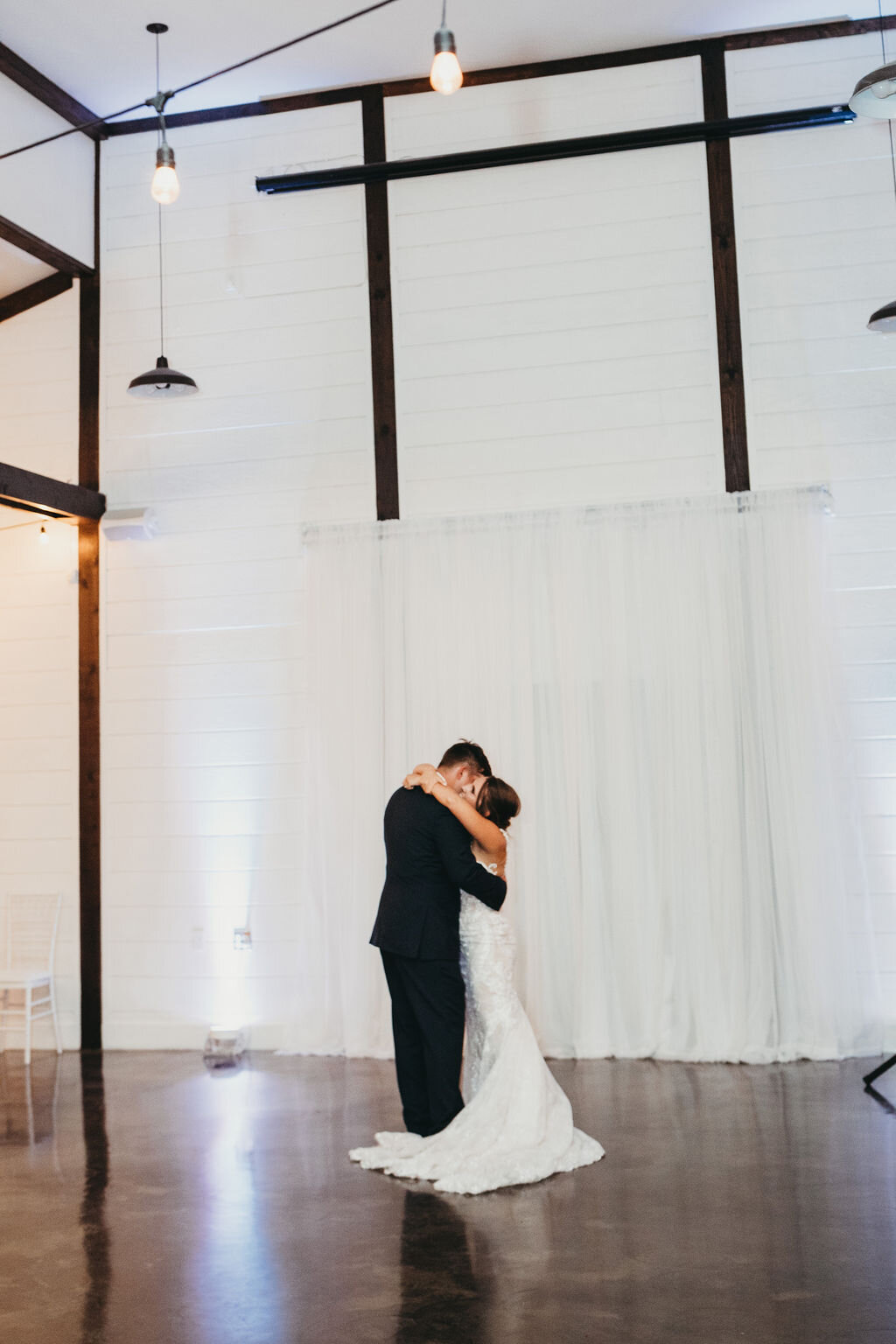 Light, Airy Tulsa White Barn Wedding Venue with a view 63e.jpg