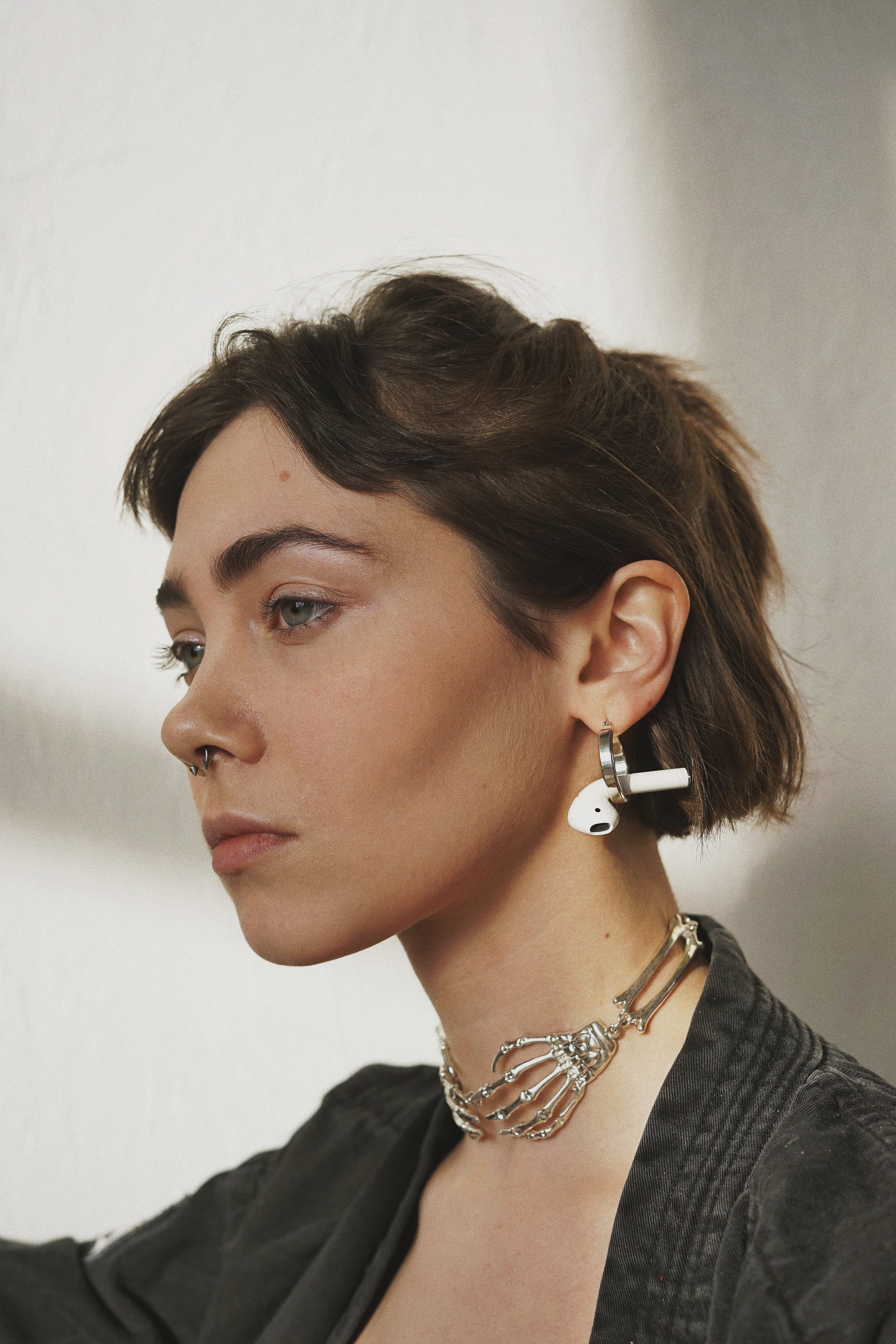 hearables-woman-airpods-earrings-pierced-beetle-moment-podcast.jpg