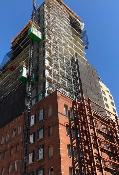 100 VandamTops Out! - August 22, 2019This residential conversion project has officially topped out with 19 stories of new construction atop the original 6 story structure.Skyline Windows is excited to be manufacturing and installing the Series 500-4 Tilt & Turn for Hudson Square's new development which will have 70 residential units.Click the photo for additional info!{ Via newyorkyimby.com }