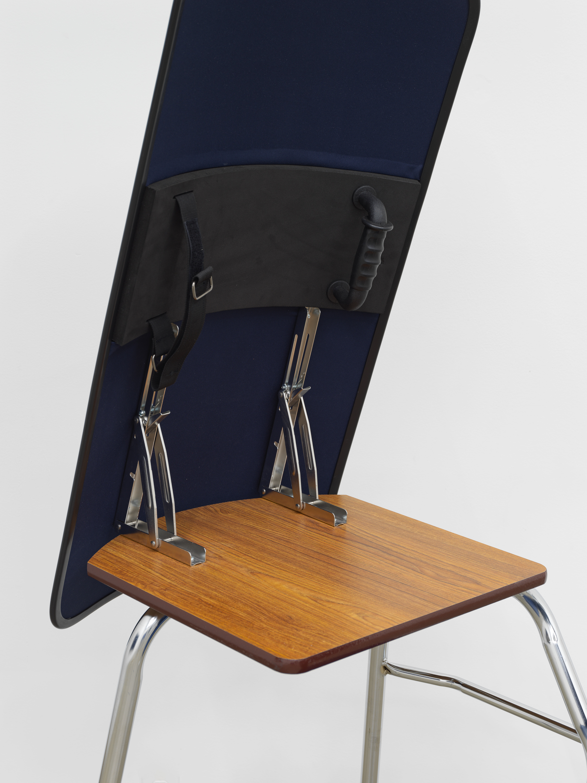 American Artist  I'm Blue, 1 (Detail) , 2019, school desk, hardware, ballistic shield, navy blue fabric, books, 66 x 24 x 35 in (167.6 x 61 x 88.9 cm)