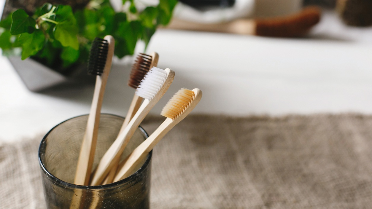Eco+natural+bamboo+toothbrushes+in+glass+on+rustic+background+with+greenery.+sustainable+lifestyle+concept.+zero+waste+home.+bathroom+essentials%2C+plastic+free+items.jpg
