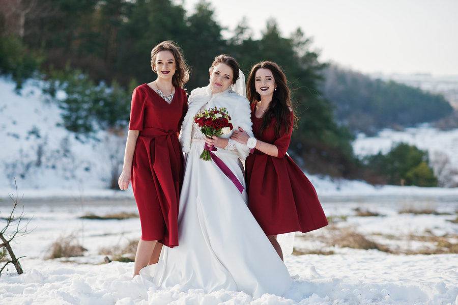 bigstock-Pretty-Bridesmaids-On-Red-Dres-165151553.jpg