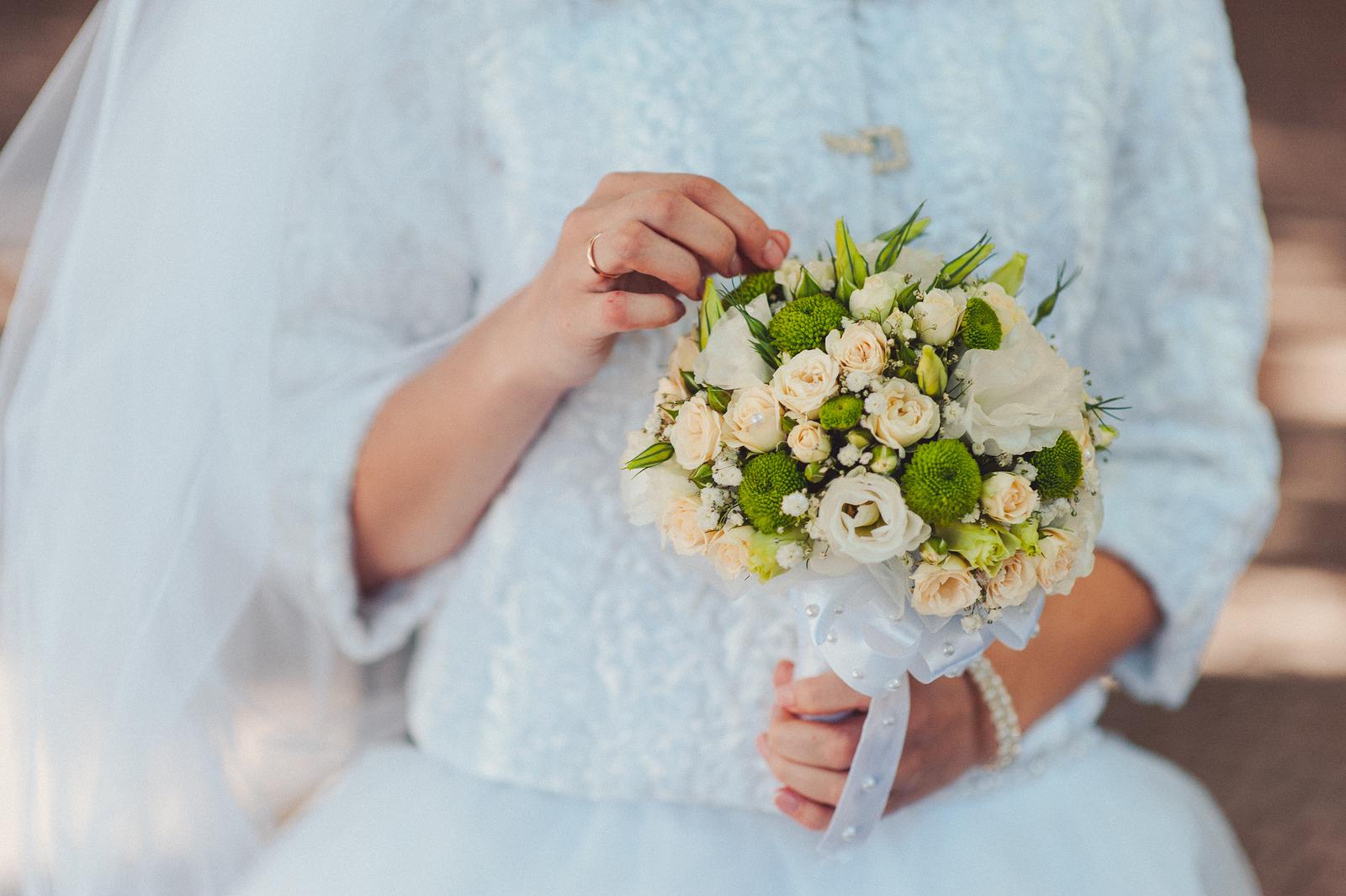 bigstock-Bride-Holding-Big-Wedding-Bouq-195104521.jpg