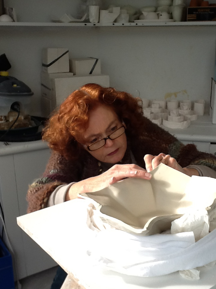 Tidying up the plate for firing.jpg