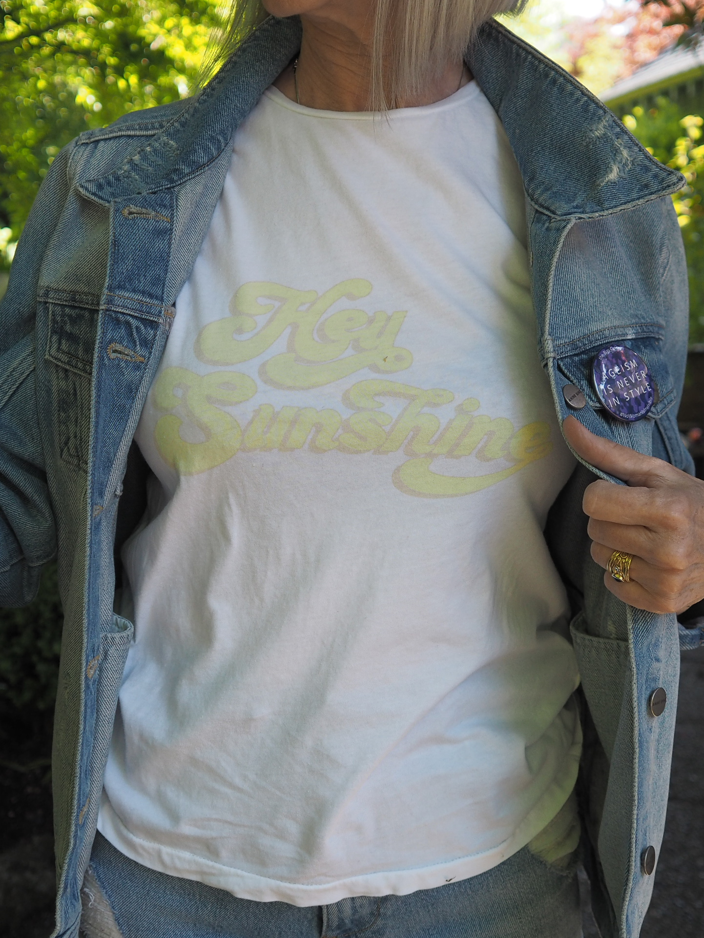 """Such a cool vintage 70's vibe from this one that says """"Hey Sunshine"""". It speaks to my teenage self. Also with this jean jacket I wear my Ageism is Never in Style button from The Bias Cut.com"""