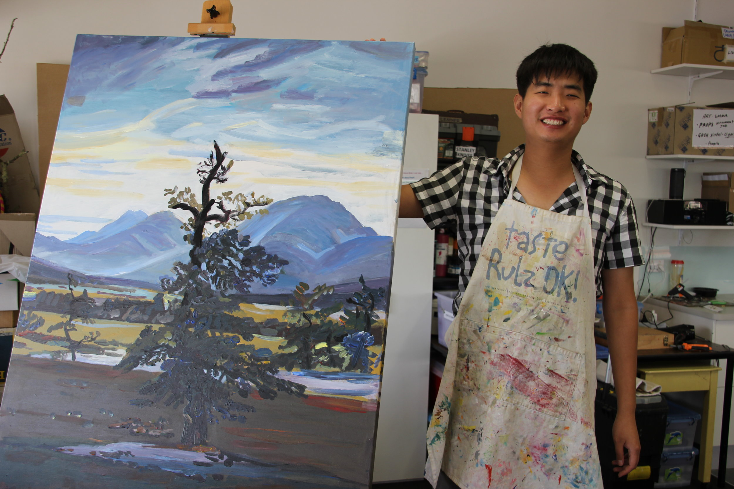 """I'm making a painting of trees. I found the picture at the art room. I'm painting a nice piece for the exhibition"" - Daniel"