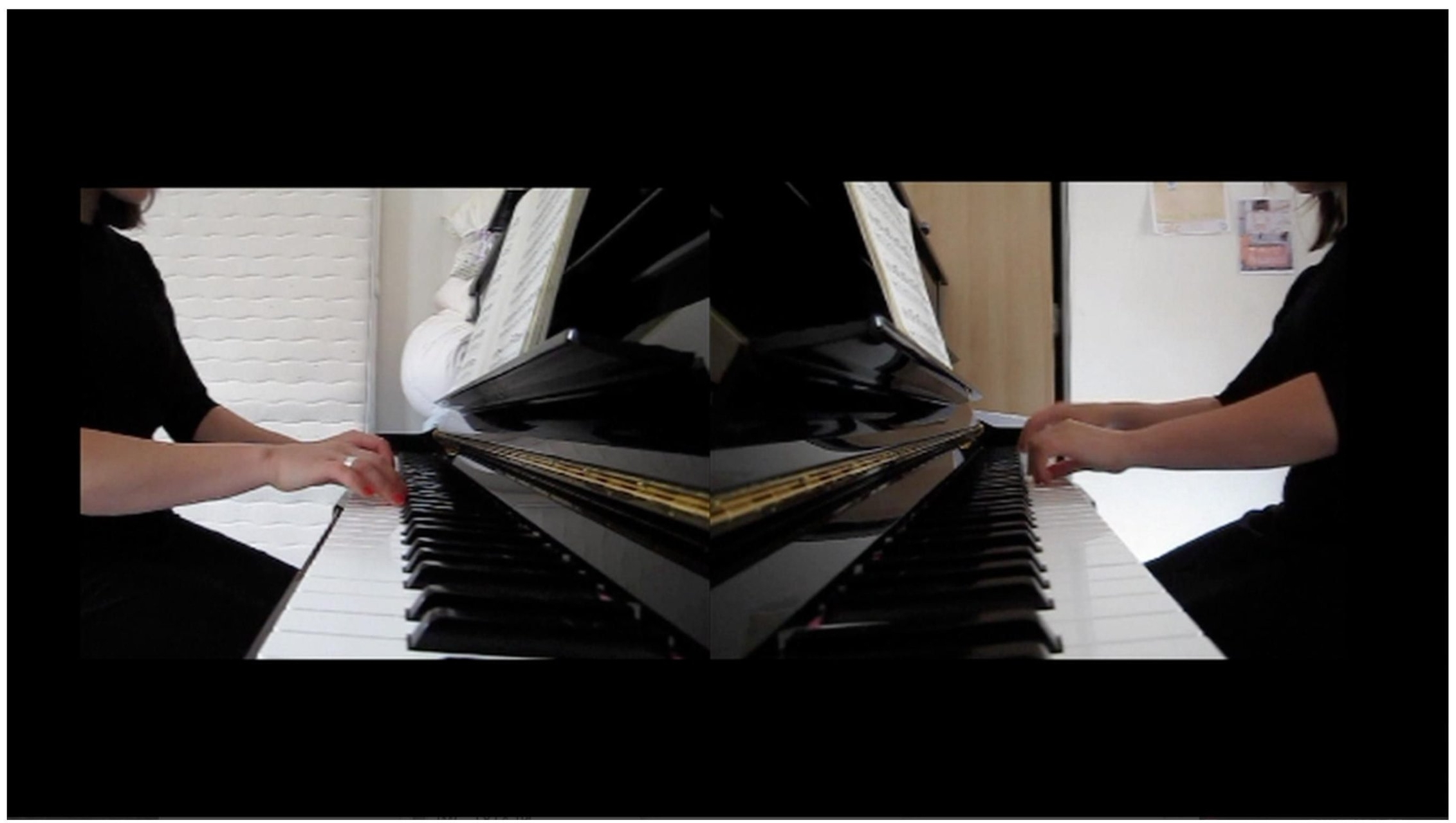 Piano four hands  video, 2m08, 2013.   Two different versions of Bach's Prelude No.1 in C major are superimposed via two video shots played side by side.  Synchronicity is initially maintained however, as the piece goes on, the dissociation becomes too great and the music disintegrates.