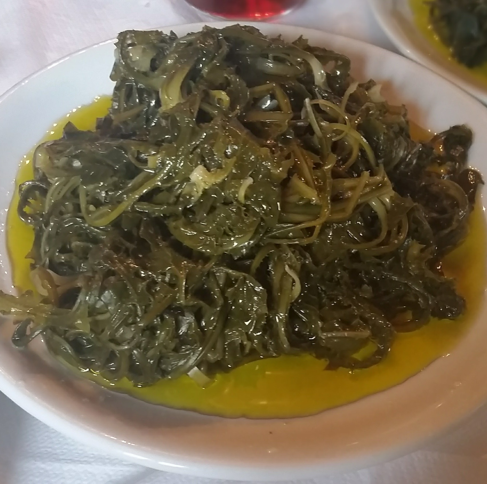Wild greens (horta) served with olive oil in Greece
