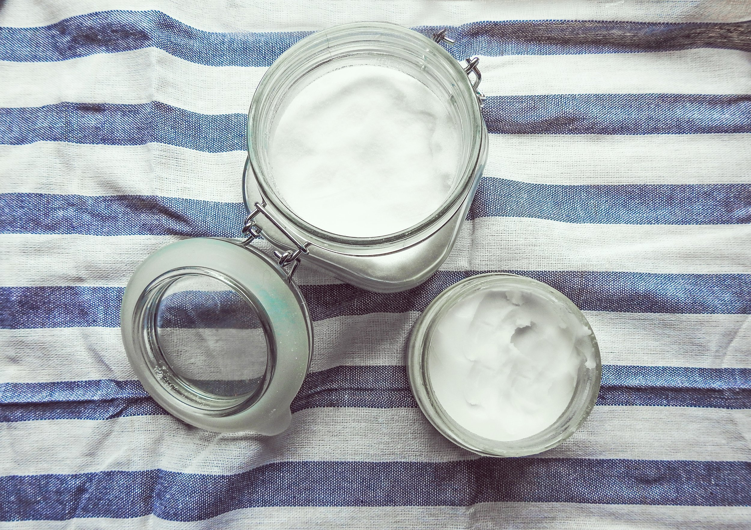 clear glass airlock container with yogurt