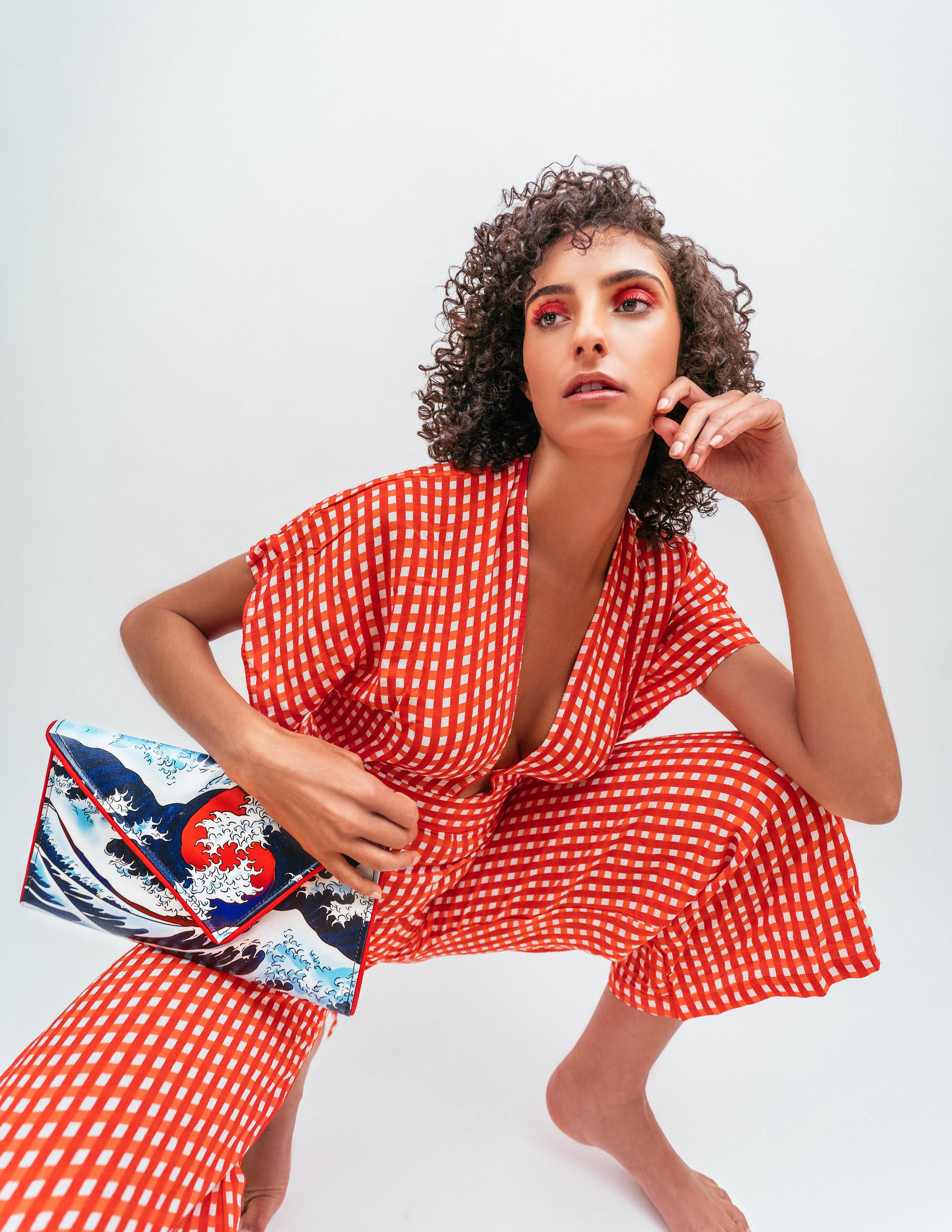 Jumpsuit: Zara, Handbag: Kent Stetson