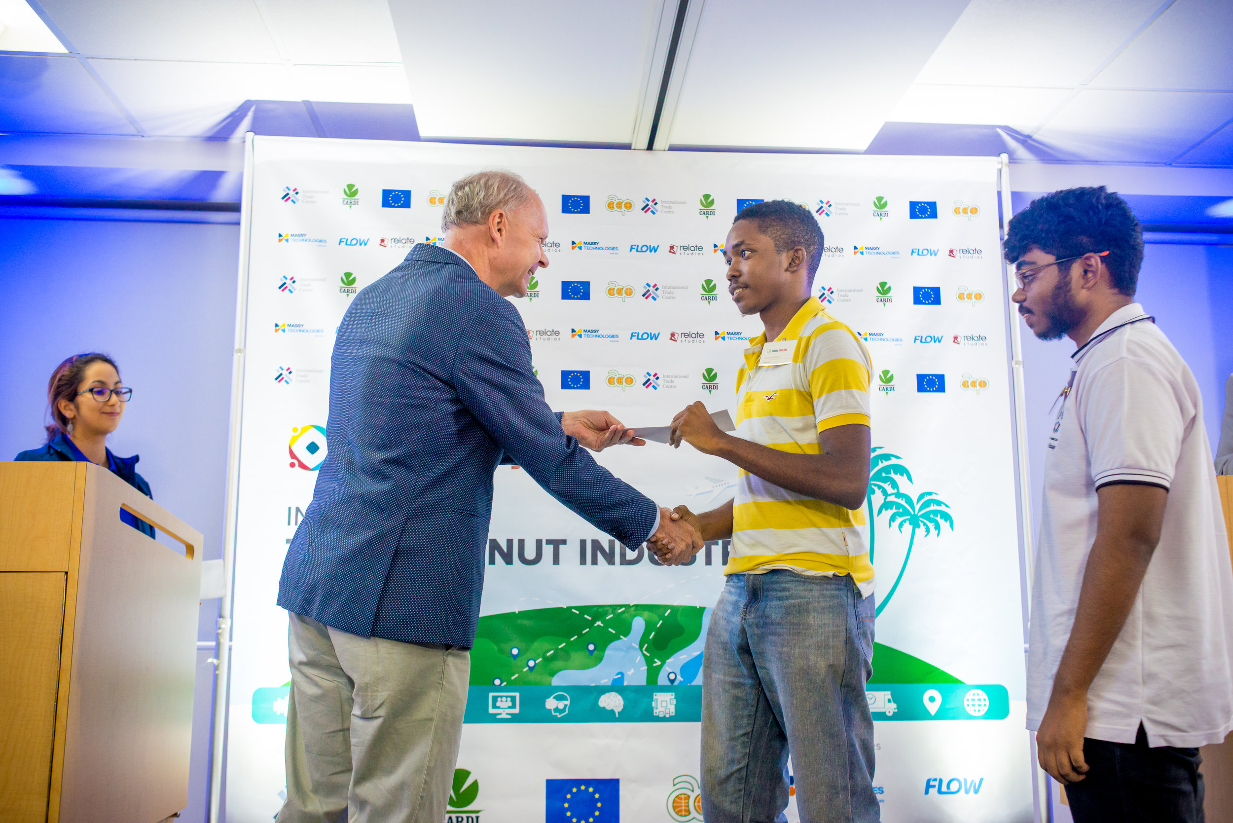 Team OJ, Omari Lawrence and Justin Ramjattan receiving their prize from Dr. Ulrich Thiessen, Cooperation Programme Manager, Delegation of the European Union to Trinidad and Tobago.