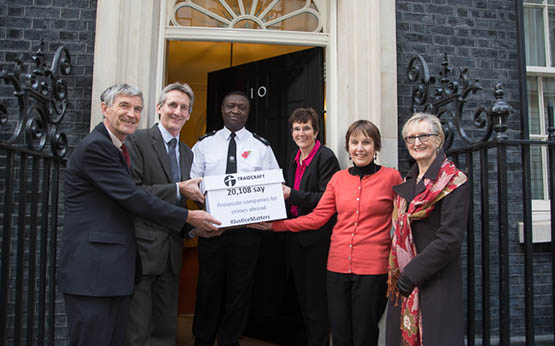 Traidcraft staff and campaigners hand in the 'Justice Matters' petition to Number 10 Downing Street