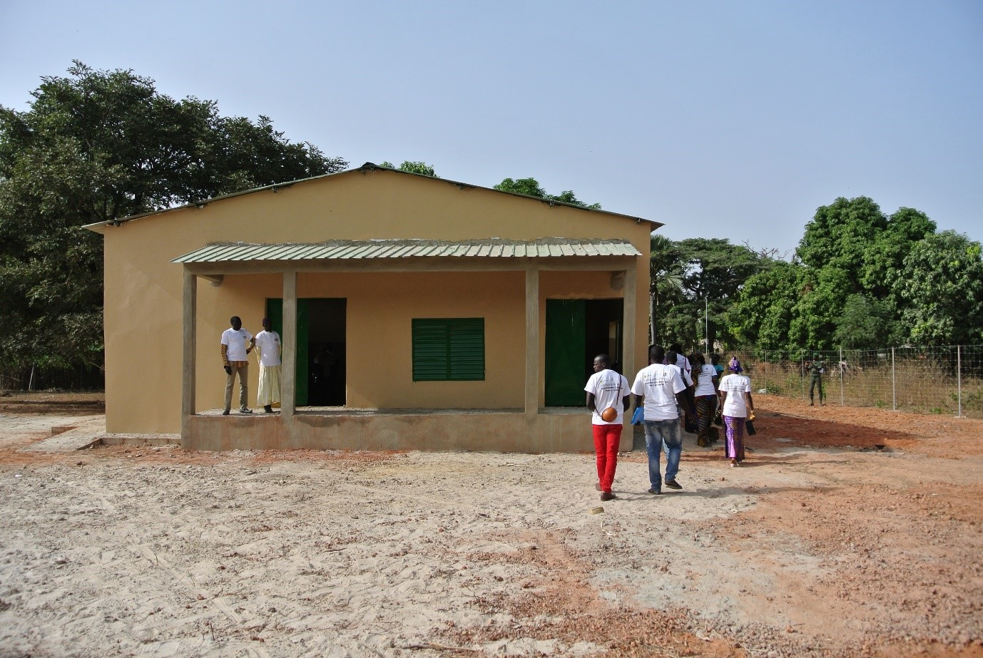 Members of various farmer groups visiting the near completed collection centre at Djinaky