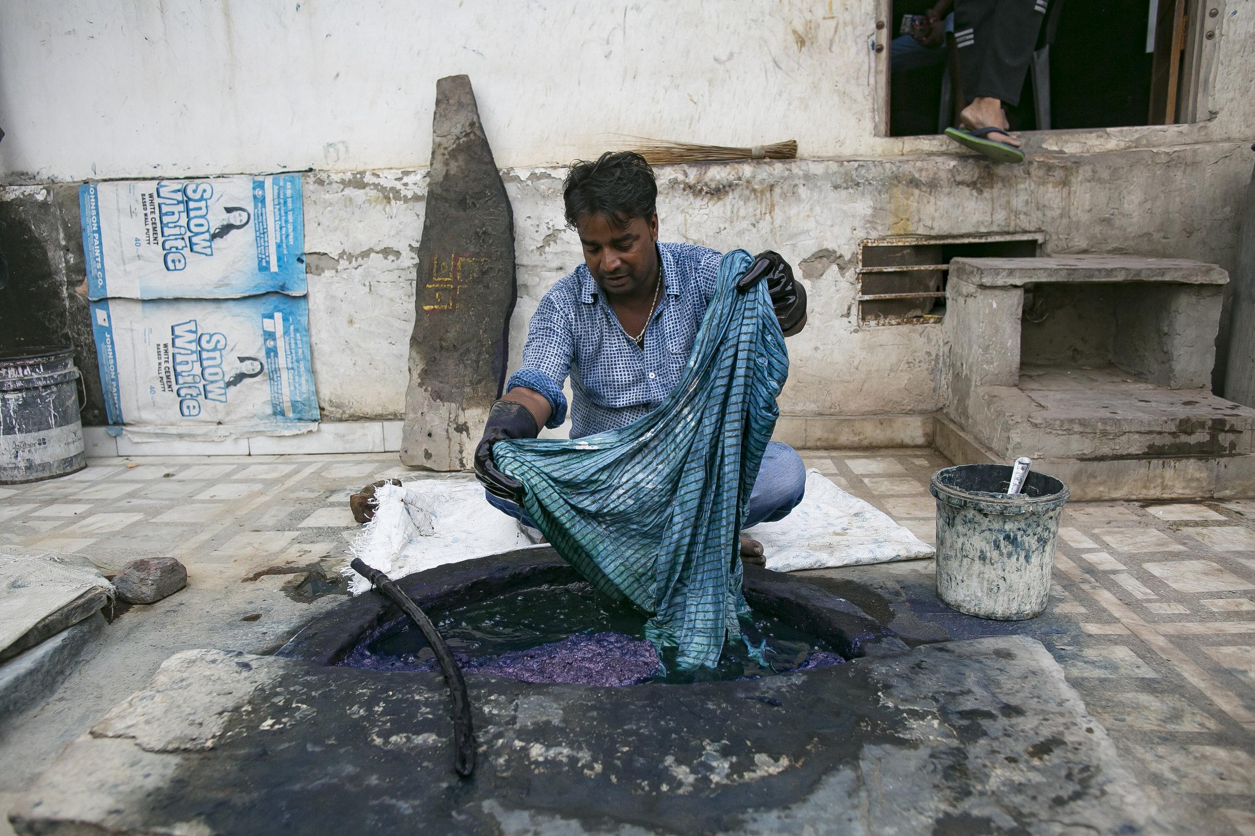 - Govind dyeing textiles in his shop in Jaipur. Credit: Traidcraft Exchange/Allison Joyce