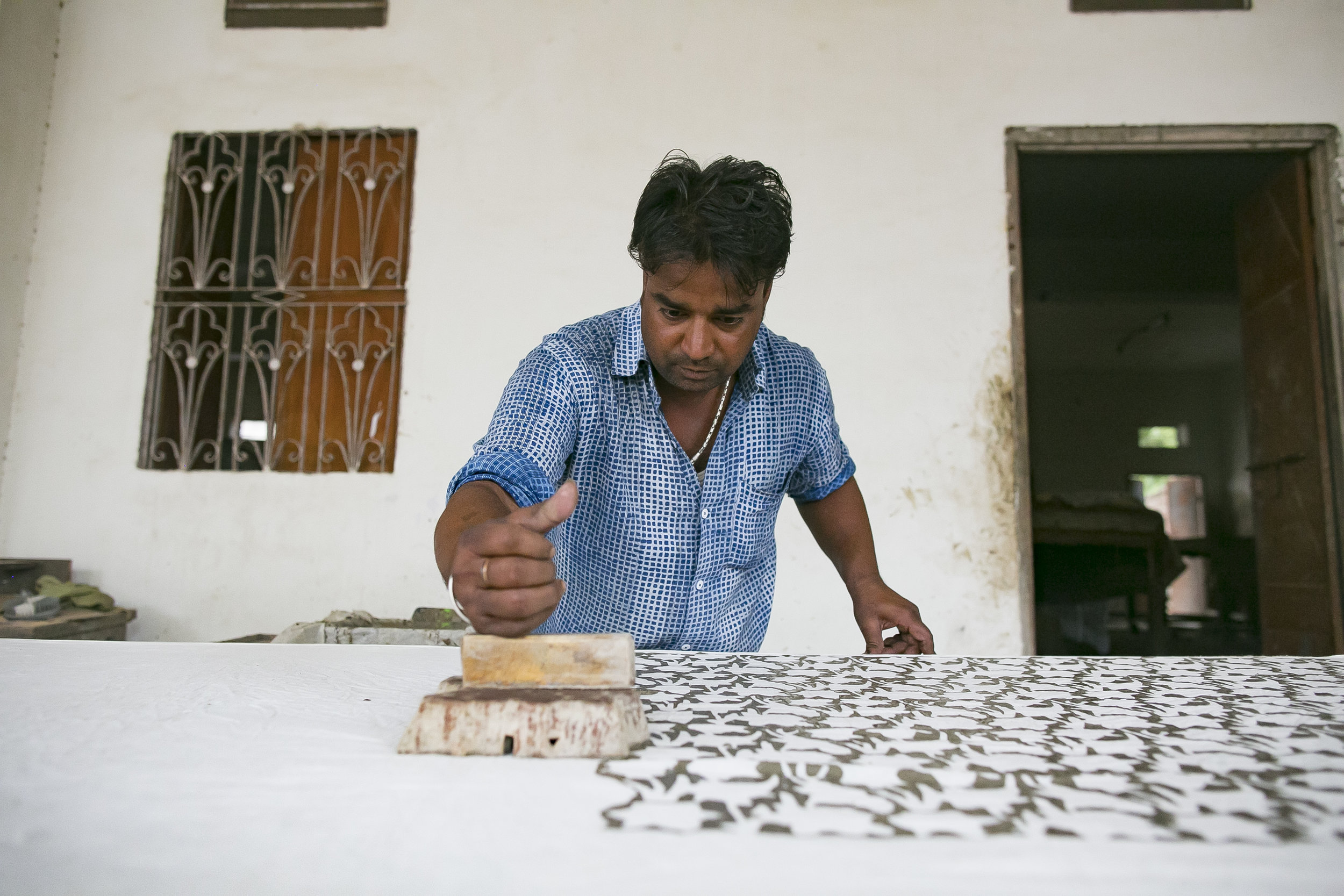 - Govind hand-printing textiles in his shop in Jaipur.Credit: Traidcraft Exchange/Allison Joyce