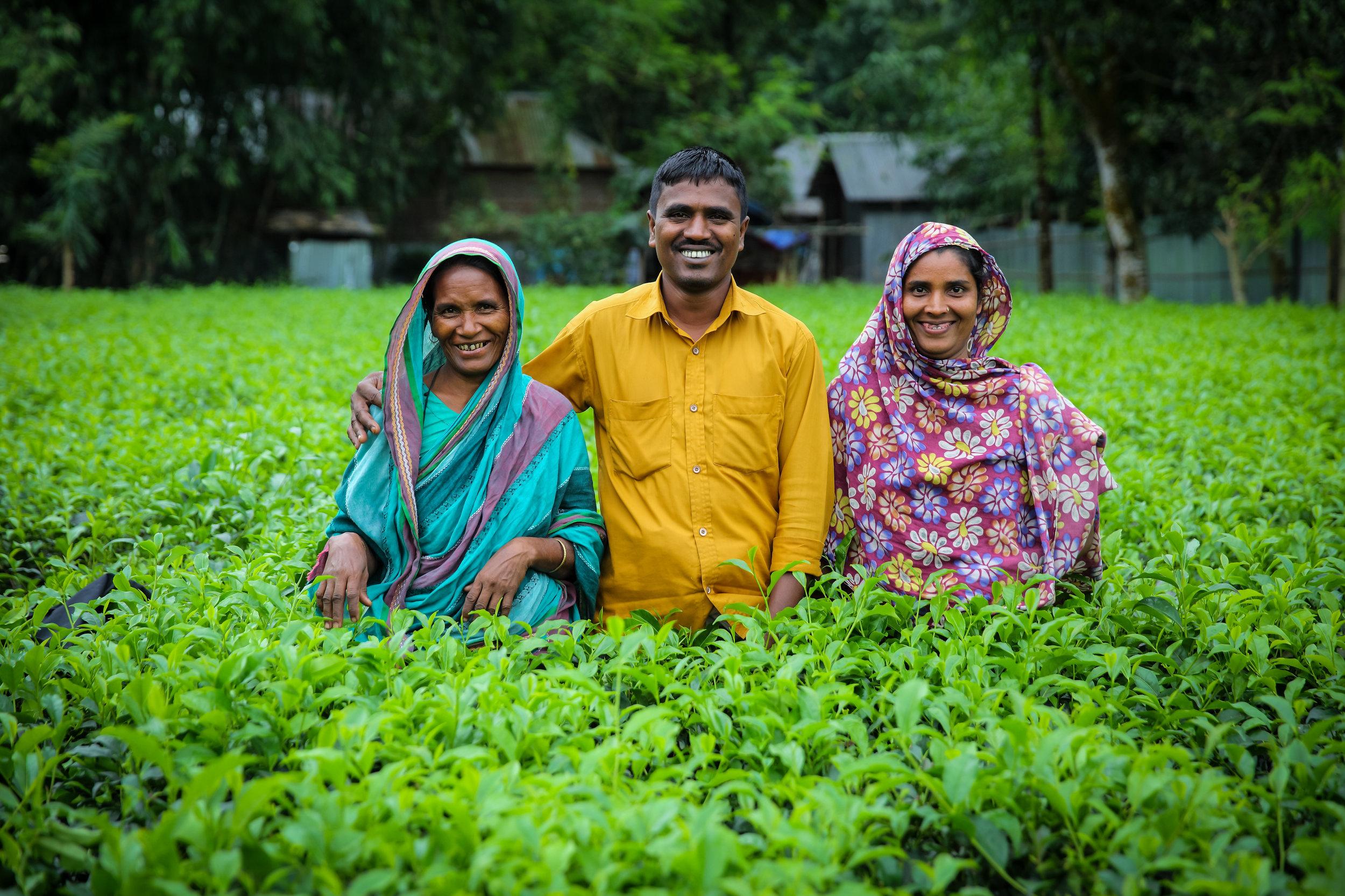 Smallholder tea farmer Maleka Khatun, left, with her family. Credit: Traidcraft Exchange/GMB Akash