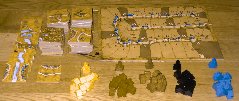 Those meeples, from left to right, are yellow, red, green, black and blue. This filter simulates Deuteranopia, or 'green blindness'. Image borrowed from  https://geekdad.com/2014/12/carcassonne-2/ .