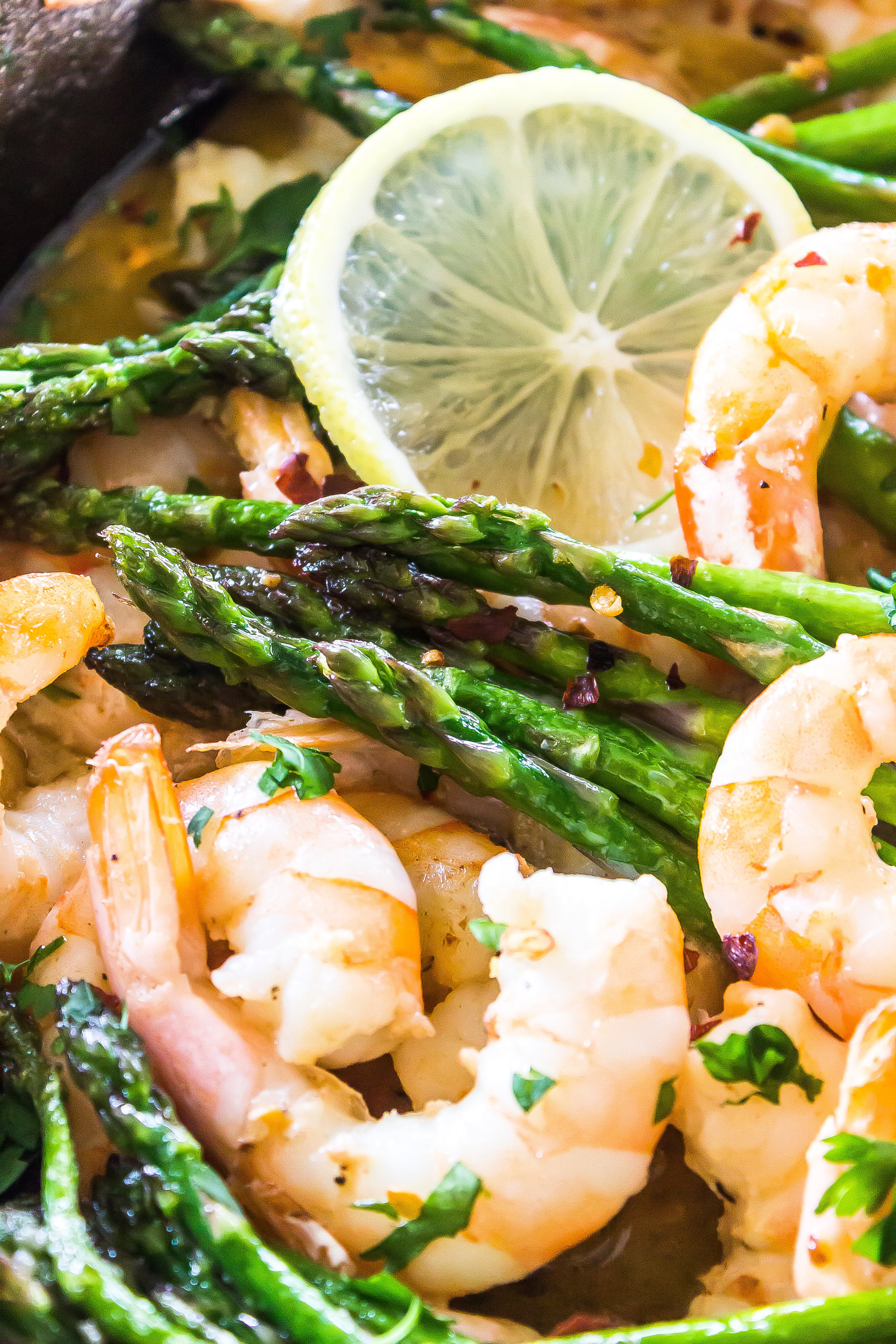 This Keto Garlic Butter Shrimp and Asparagus Skillet is ready in less than 20 minutes and has less than 5-ingredients! #keto #lowcarb #ketorecipe #lowcarbrecipe #lchf #5ingredient #20minutemeal #easyrecipe #recipe #glutenfree