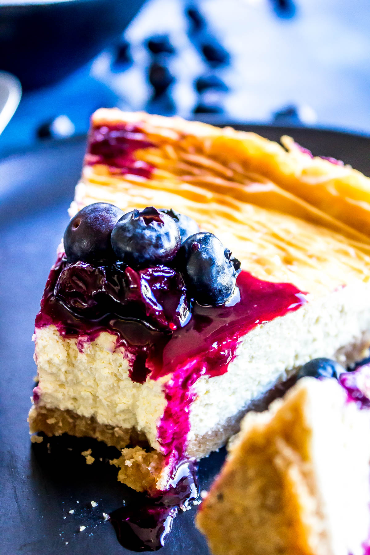 This Easy Keto Cheesecake is creamy, sweet, and totally delicious. Made in a cast iron skillet it's perfectly cooked - top it with your favorite toppings (we used fresh blueberries simmered with just a bit of Swerve) #keto #ketorecipe #lchf #lowcarb #lowcarbrecipe #easyrecipe #ketodessert #glutenfree
