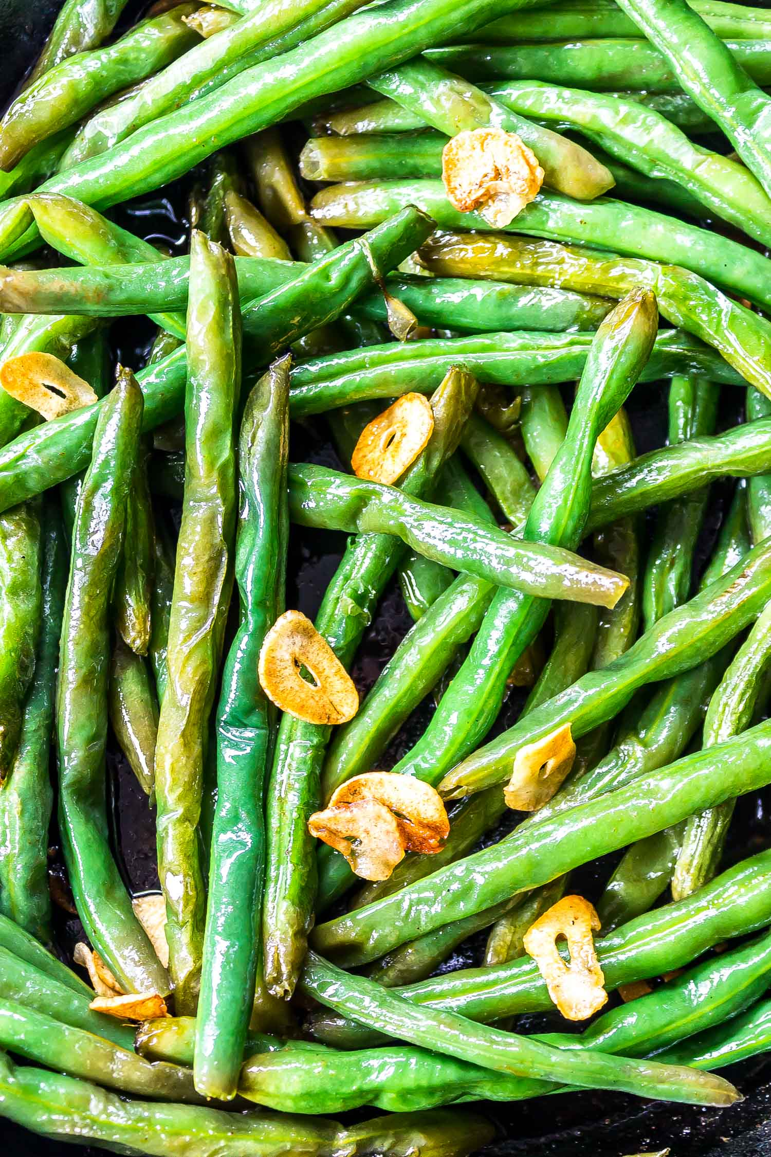 These Easy Garlic Butter Green Beans are packed with crispy garlic and make a great addition to any meal. They're low-carb, keto, gluten free, and super tasty! #glutenfree #keto #ketorecipe #ketorecipes #ketodiet #lchf #lowcarb #lowcarbrecipe #lowcarbrecipes #lowcarbdiet #ketosis #healthyrecipe #easyrecipe