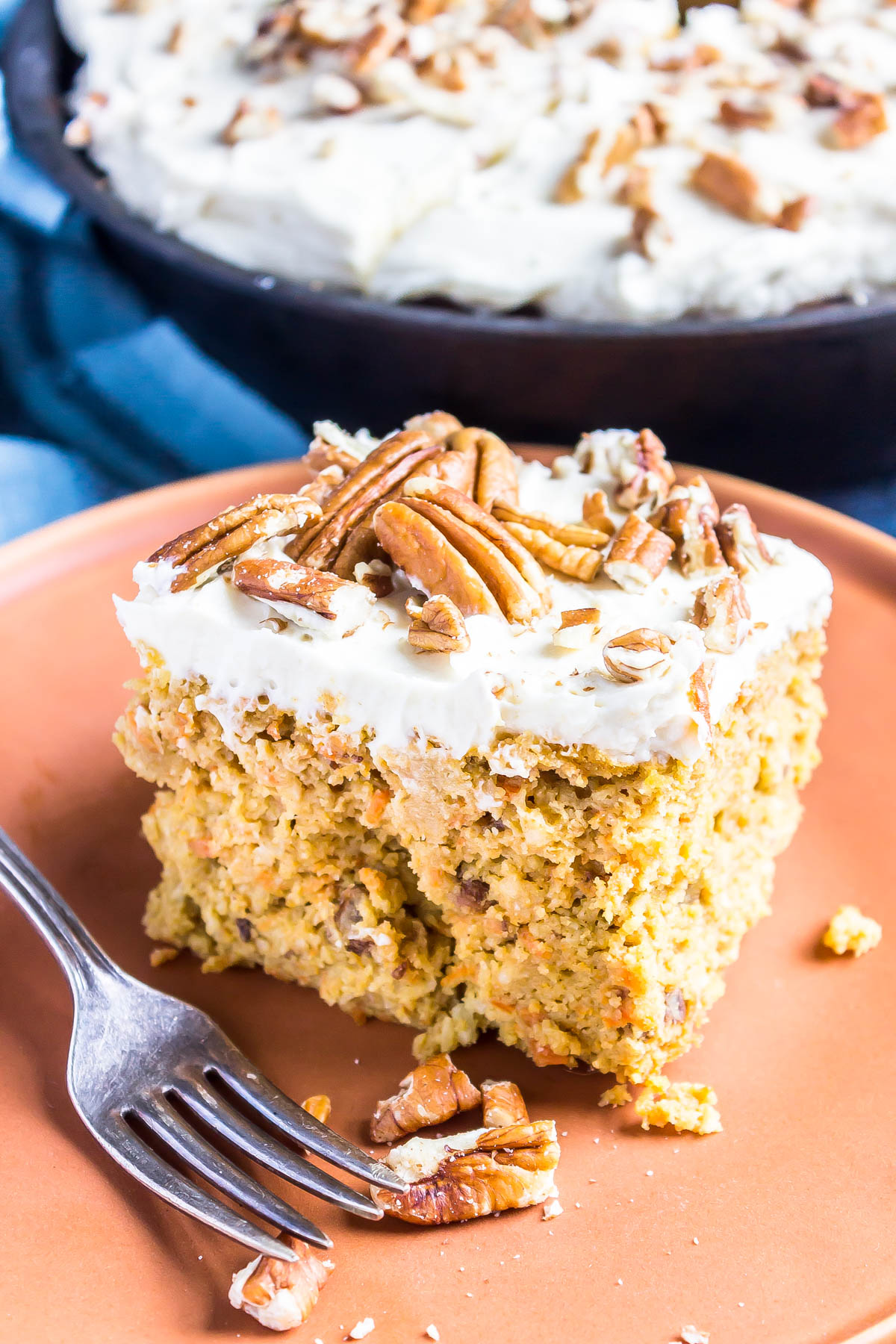 This easy Keto Carrot Cake is perfect for Easter but is a low-carb dessert you wouldn't mind baking all year around. #glutenfree #castiron #ketorecipe #keto #ketogenic #lowcarbrecipe #lowcarb #recipe #easter #easterrecipe #eastercooking #lchf