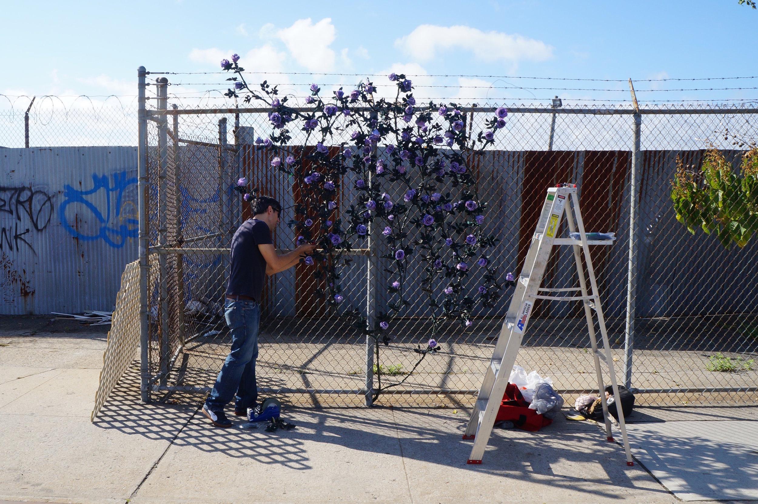 "Carlton Scott Sturgill installs ""Bridge of Flowers"" along the Union Street crossing of the Gowanus Canal (2014)."