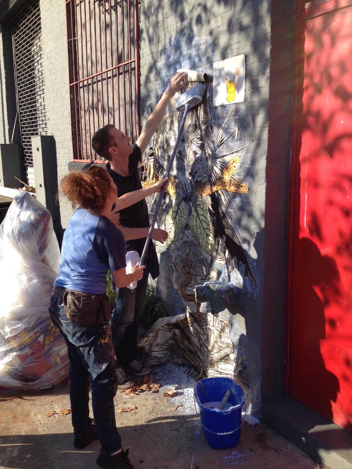Artist, Swoon, installs a wheatpaste mural on Douglass Street in honor of Gowanus Open Studios 2013.