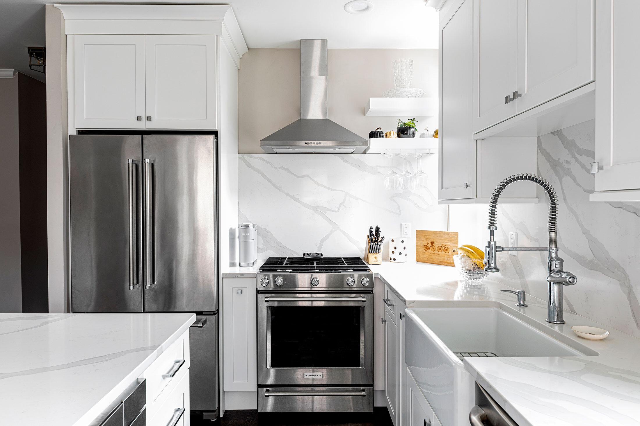 thompson-fine-home-renovations-hoboken-kitchen-marble-stainless-steel-appliances.jpg