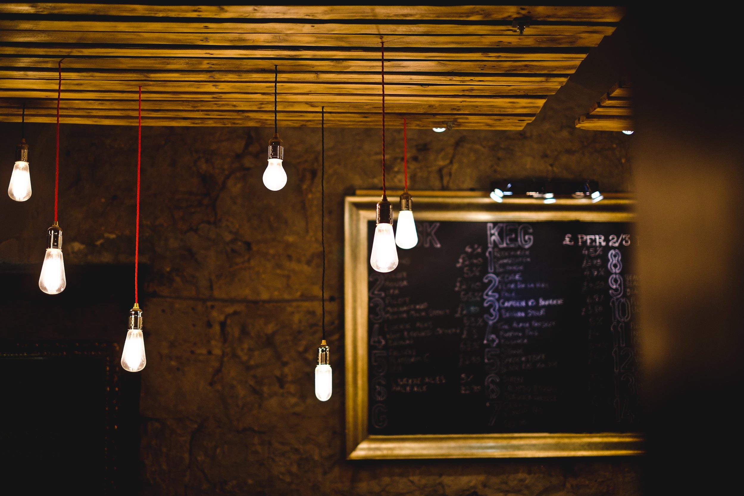 Low hanging lightbulbs in pub