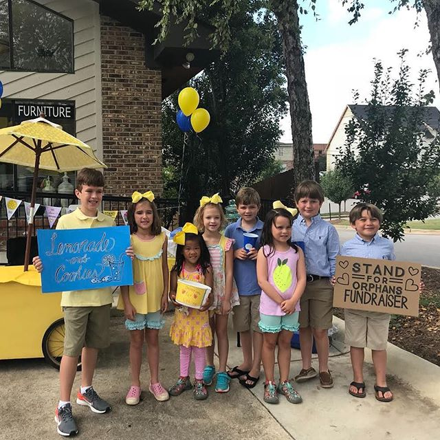 These kiddos from @lm_design_build_furnish are out selling lemonade today to raise money for Lifeline's Stand for Orphans.L&M will even match all proceeds raised so go out and support this great cause.🍋 #drinklemonade #supportadoption #standfororphans #downtownauburn