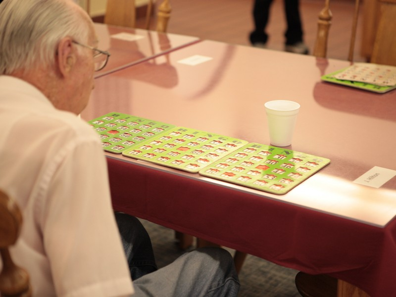 Playing Bingo in the Sun Room at Somerset Court