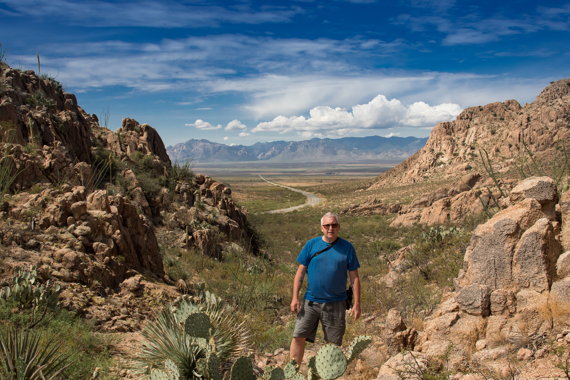 Mark at Granite Gap, Peloncillo Mountains, with Highway 80 heading south and the Chiricahua Mountains in the background.