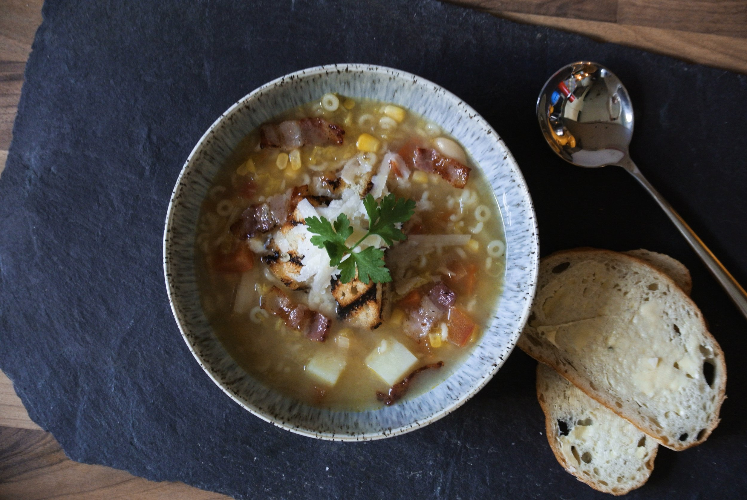 Homemade Minestrone Soup with Croutons and Parmesan