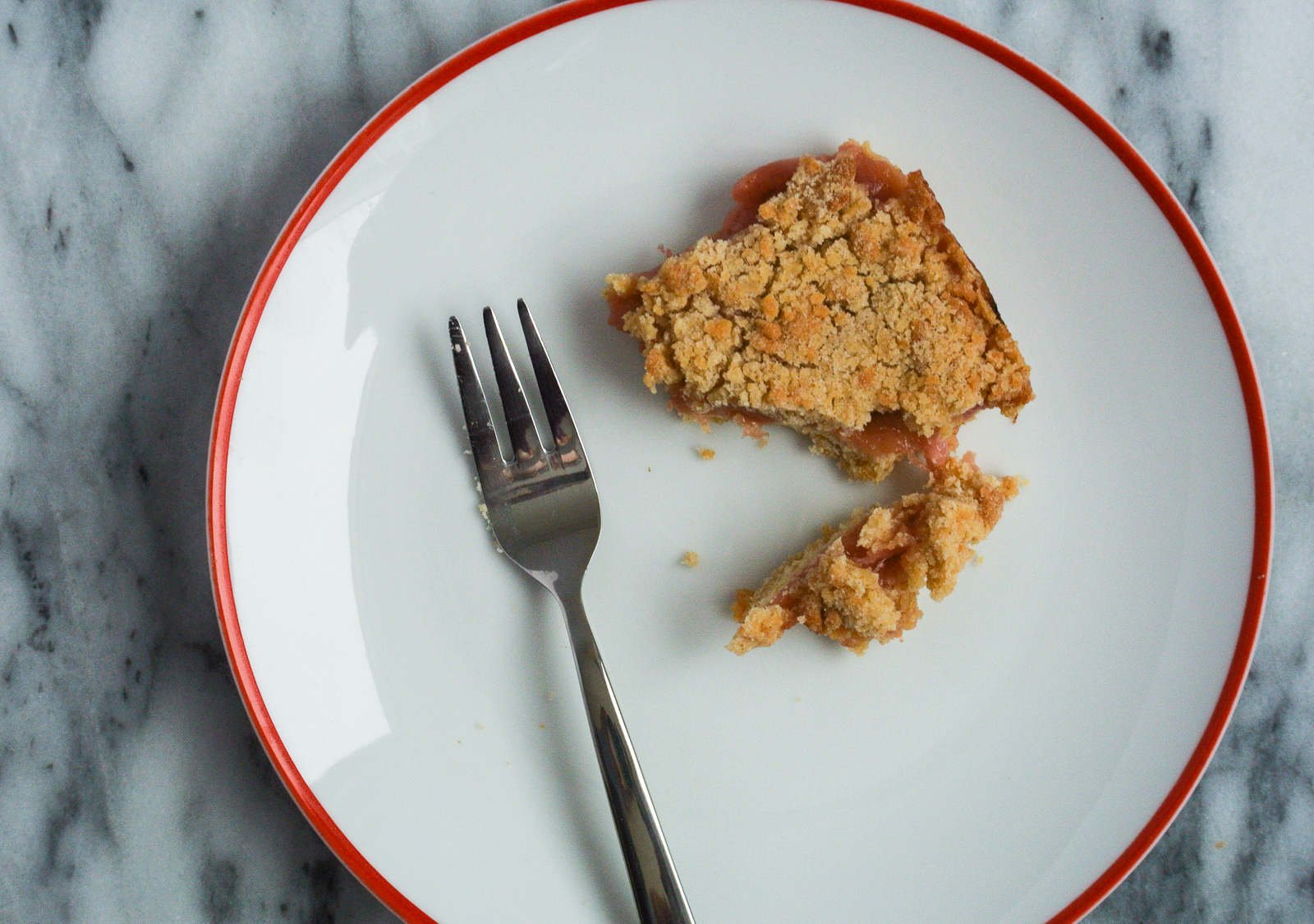 rhubarb crumble bar on plate with dessert fork