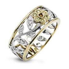 MR1000  - 0.29 ct White Diamond & 0.03 ct Yellow Diamond Set In 18K White & Yellow Gold.  List Price: $2,200    Our Price: $1,760