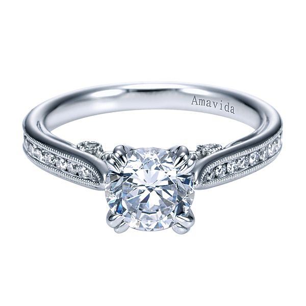 ER7216  – 1.00 CT Center Stone Set In A 0.36 ct Setting In A 18K White Gold Band.  List Price: $2,155