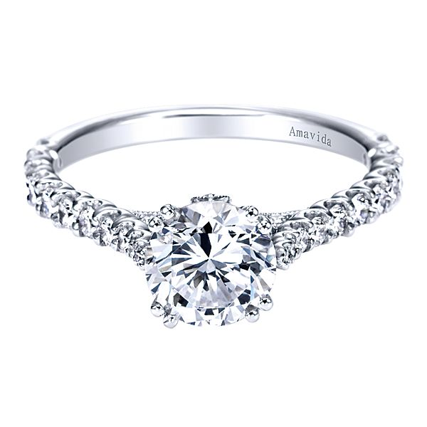 ER7374  – 1.00 CT Center Stone Set In A 0.59 ct Setting In A 18K White Gold Band.  List Price: $2,565