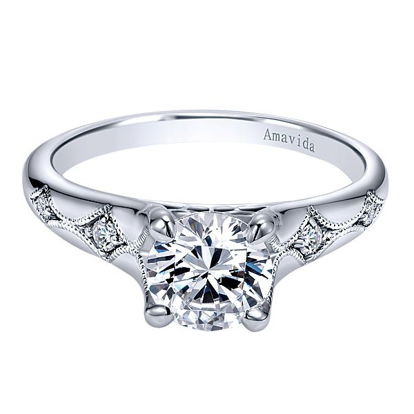 ER11913  – 1.00 CT Center Stone Set In 0.06 Setting In A 18K White Gold Band.  List Price: $990