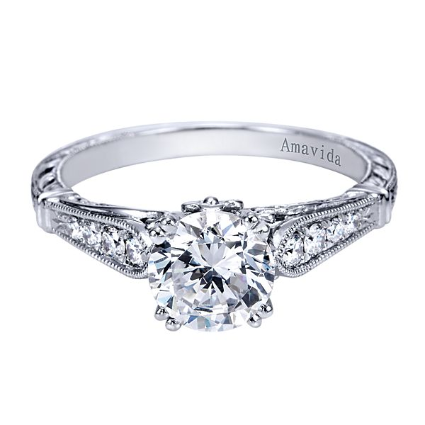 ER6495  – 1.00 CT Center Stone Set In 0.14 ct Setting In A 18K White Gold Band.  List Price: $1,780