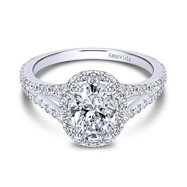 ER7522  – 1.00 CT Center Stone Set In A 0.66 ct Setting In A 18K White Gold Band.  List Price: $2,880