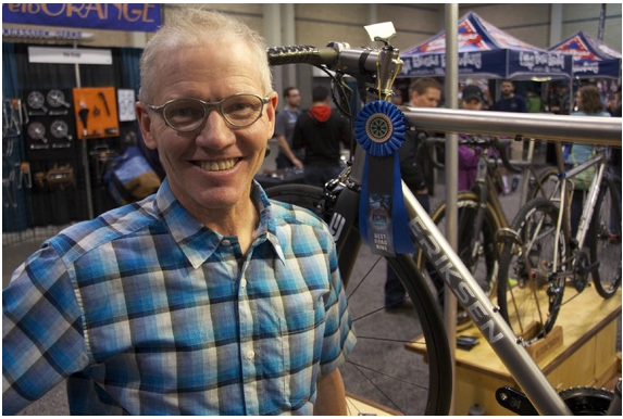 """Veteran bike builder Kent Eriksen strives for perfection in his bikes. """"I'm looking for a bike that rides perfectly straight, perfectly aligned,"""" he said. """"If the rider wants to ride downhill at 60 miles per hour with no hands on the bars, they ought to be able to do that."""" (Christina Cooke)"""