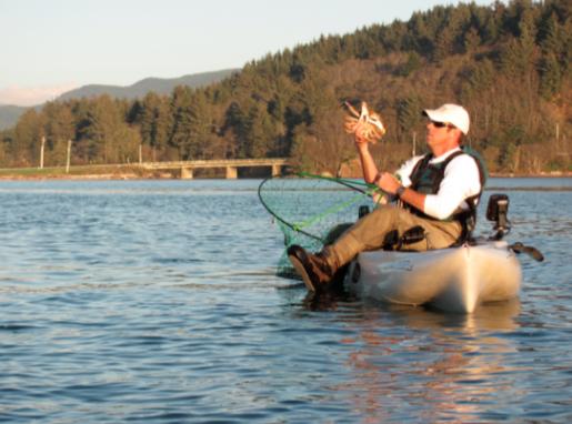 PADDLE MAN: Expert kayak fisherman Michael Rischer enjoys a float on Siletz Bay.