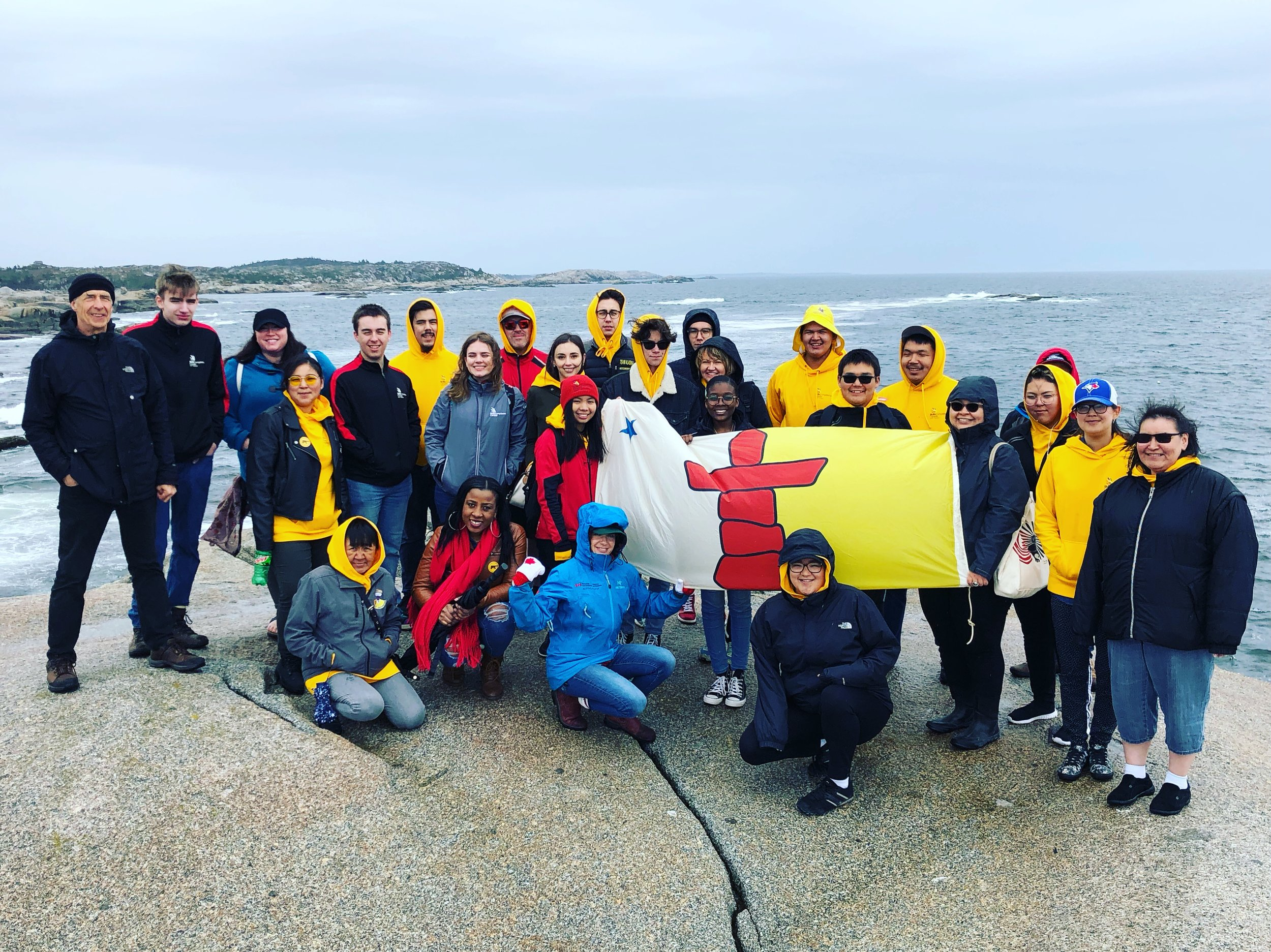 2019 Team Nunavut members exploring the Atlantic ocean with a hike along the rocks at Peggy's Cove, NS.