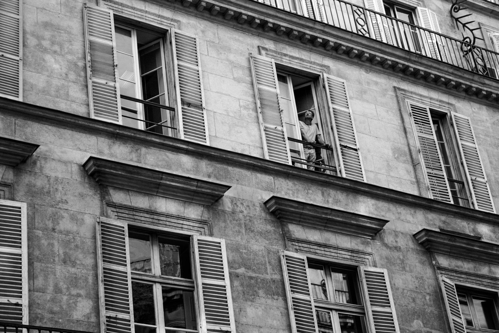 Man looking out window .jpg