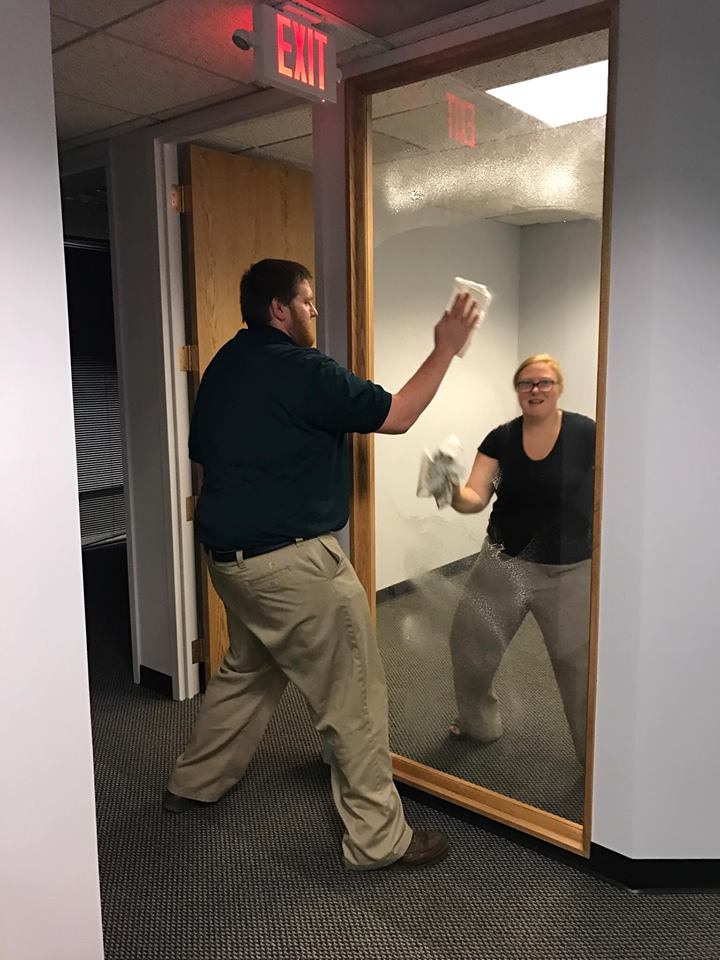 matt and mel cleaning window.jpg