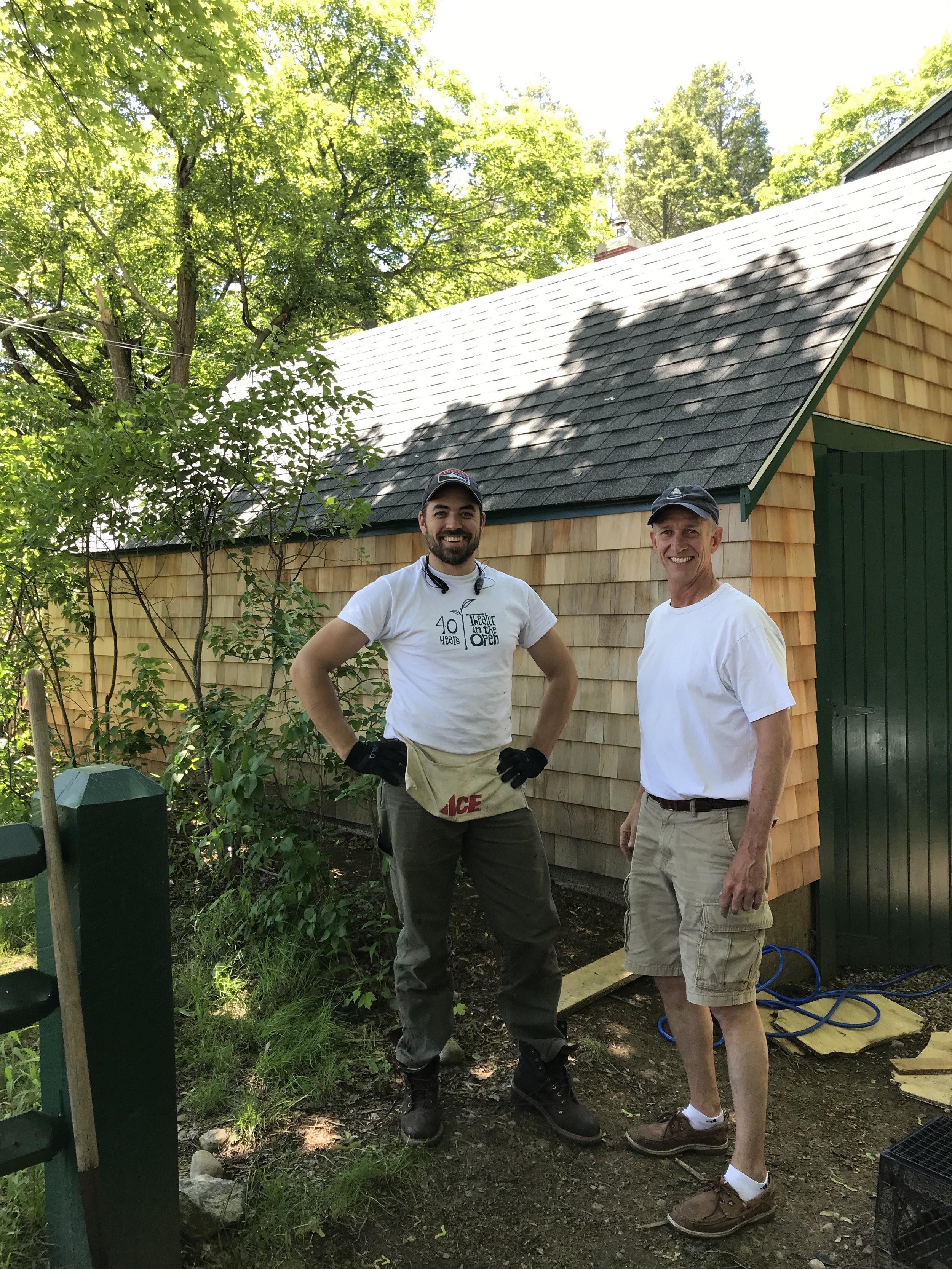 Artistic Director Teddy F. Speck and a volunteer with the finished garage project.