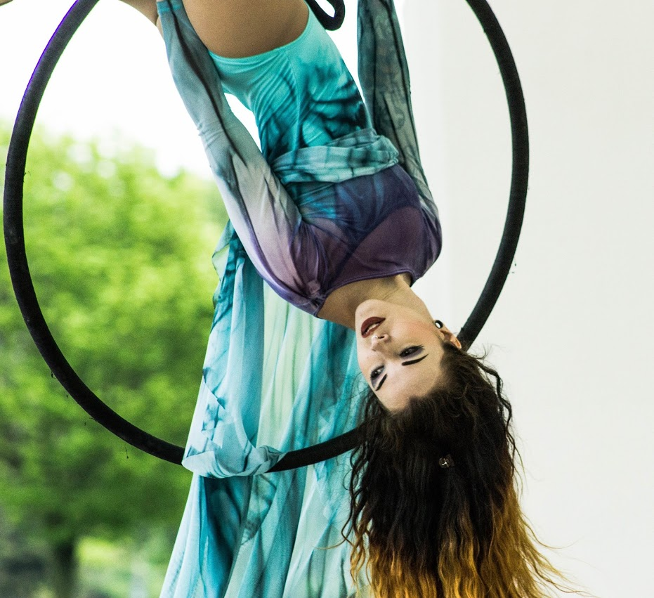 Samm Haney - AERIAL HOOP (LYRA) INSTRUCTORSamm is a Buffalo native. Samm comes from a strong ballet and musical theatre background, and has been training and performing on Lyra since 2015. She is constantly furthering her education in the aerial arts by training with instructors abroad and at home.Samm enjoys combining flexibility and strength in her training, and takes a special interest in spinning choreography in her acts. She looks forward to helping students increase their strength and body awareness, as well as their self-confidence as they discover the graceful beauty of the aerial hoop.