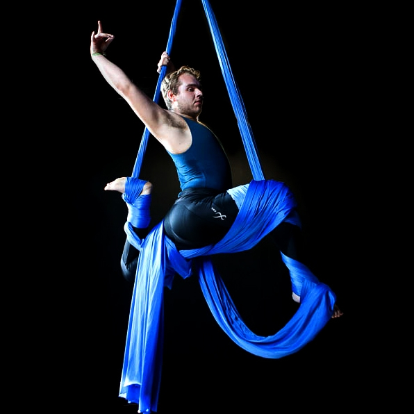Larris Acker - AEIRAL SILKS & ACTIVE FLEXIBILITY INSTRUCTORLarris has received his 1st & 2nd Aerial Yoga Teacher trainings at Aircat Aerial Arts in Boulder, Colorado in 2014 & 2015. Larris has four years of experience teaching aerial yoga, silks, aerial rope, lyra, and active flexibility classes.Larris has been trained in several movement arts including hand balance, contortion, and ballet. He has received training at both Aircat Aerial Arts and Frequent Flyers; Danza Aerea in Playa Del Carmen, Mexico; and under internationally renowned fabric instructor Fred Deb at The Collective Space in Toronto, Ontario.
