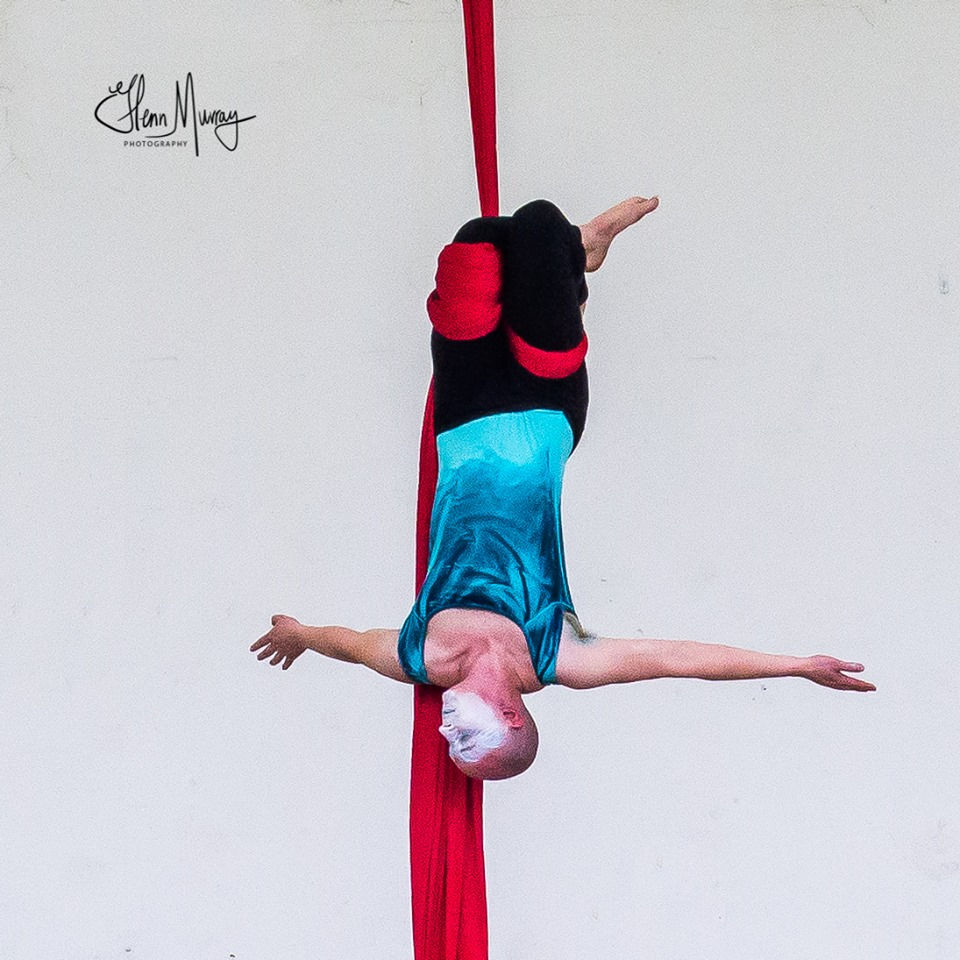 Andrew Kutnyak - AERIAL SILKS INSTRUCTORAndrew is an Aerial Silks teacher and has completed the Nimble Arts Introduction to Teaching as well as the Foundation Level Teacher Training. He began his aerial journey in 2009 and as a co-owner of Canopy Aerial Arts, has been performing in Buffalo ever since.