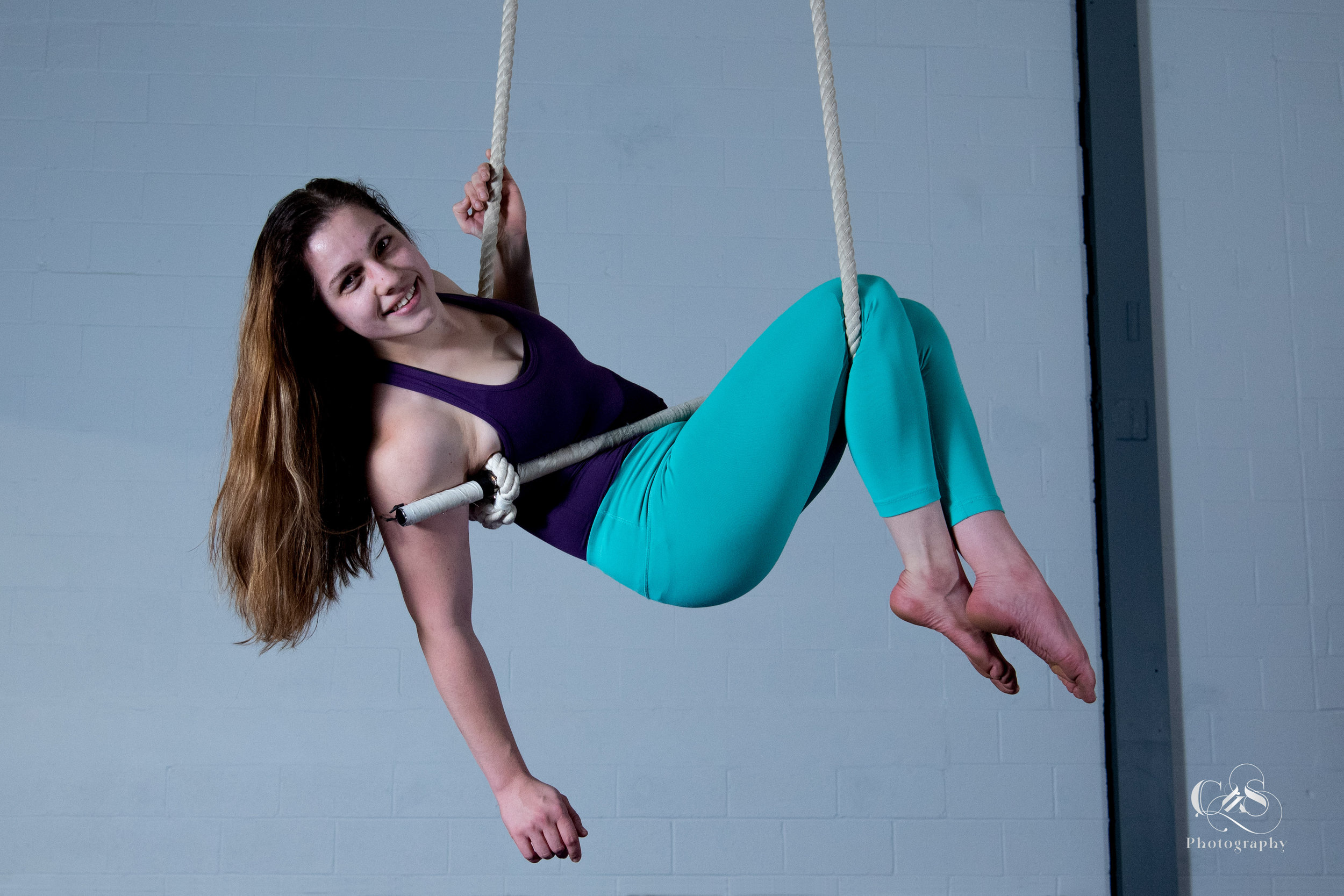 Kristen Bloom - DANCE TRAPEZE INSTRUCTORKristen is a trapeze teacher here at The Bird's Nest. She began her aerial training in 2014, and started teaching in 2018. Kristen trains and takes classes locally in Buffalo, but often travels to learn from other instructors in Toronto and NECCA. Kristen enjoys combining strength and creativity in her training. Her training currently focuses on trapeze and lyra, but she also enjoys practicing on the silks.